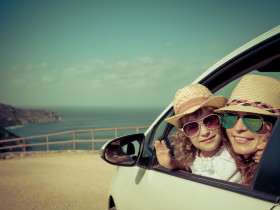 Happy family in the car. Summer vacation concept
