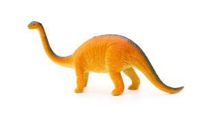 side view orange brachiosaurus toy on a white background