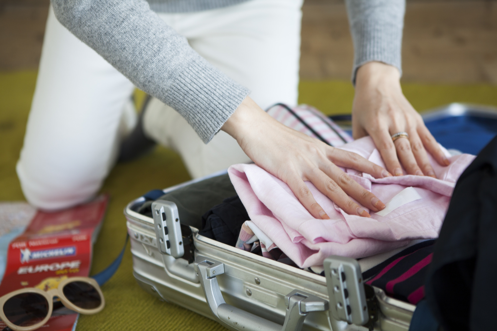 Women are preparing for travel in the room
