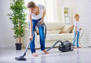 happy family cleans the room